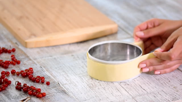 female hands making white chocolate decor for cake. - ribes rosso video stock e b–roll