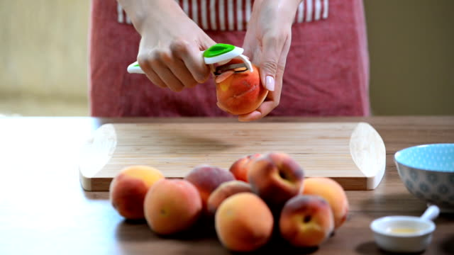 female hands peeling a blanched peach female hands peeling a blanched peach peach stock videos & royalty-free footage