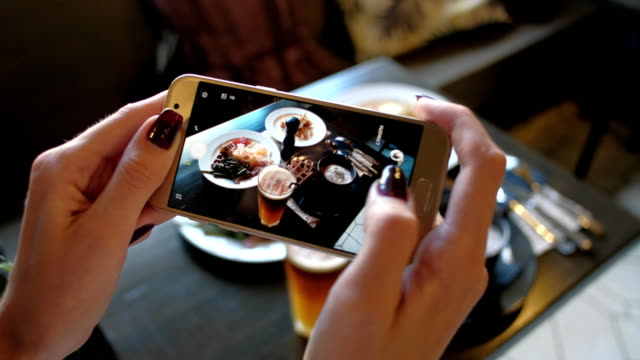 female hands photographing food by smartphone - instagram filmów i materiałów b-roll