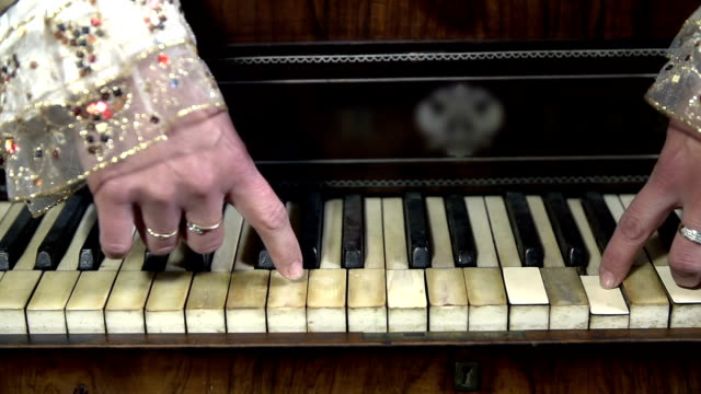 HD SLOW: Female hands play piano keys from wrong way video