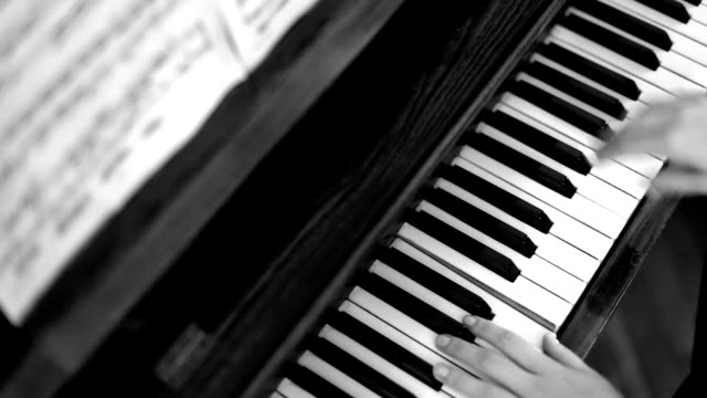 Female hands playing piano, Black and White video