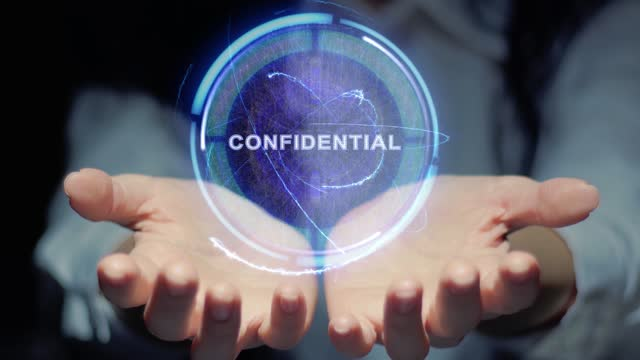 Female hands show hologram Confidential