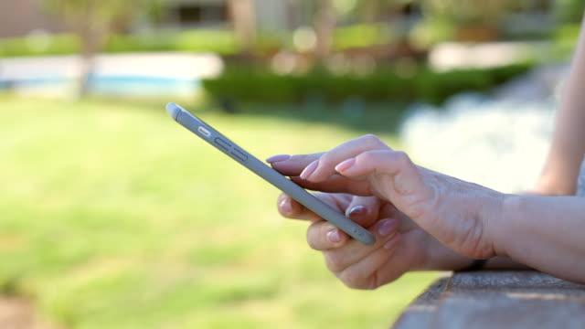 Female hands using smart phone. video