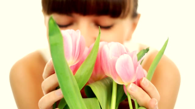 Female hands with bouquet of pink tulips, isolated video