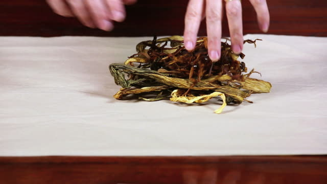 Female Hands Wraping Dehydrated Herbs video