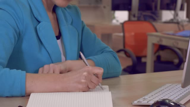 female hands writes in scratchpad - to do list video stock e b–roll