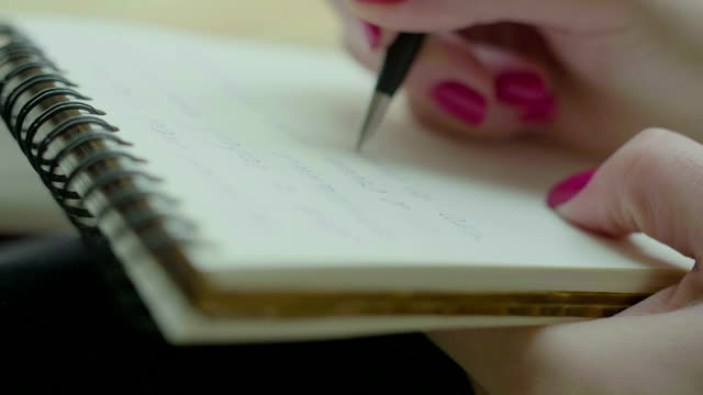 Female Hands Writing in Notepad video