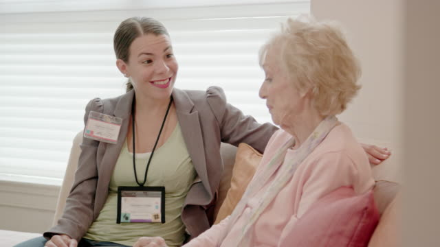 Female Healthcare Professional Talks with Senior Woman video