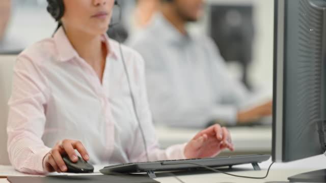 TU Female helpline operator answering a call video