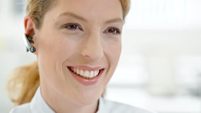 TU Female helpline operator talking to customer video