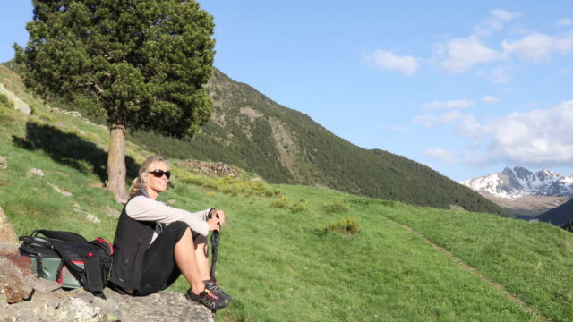 Female hiker relaxes in mountain landscape  pedal pushers stock videos & royalty-free footage
