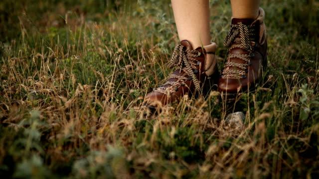 Female Hiker walks on Mountain Trail Female Hiker walks on Mountain Trail wide angle stock videos & royalty-free footage