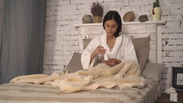 Female illness medicine in flat video
