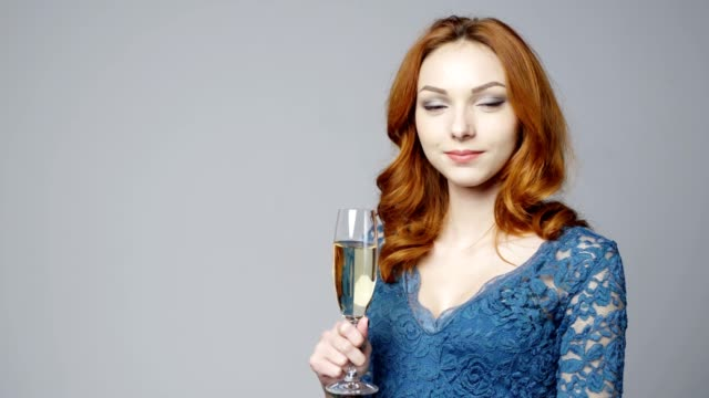 Female in lace dress with glass of champagne Portrait of redheaded female in lace dress with glass of champagne redhead stock videos & royalty-free footage