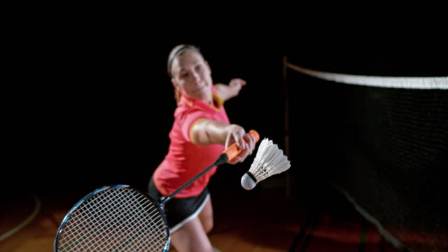 SLO MO Female indoor badminton player hitting a shuttlecock video