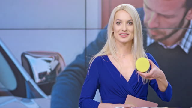 LD Female infomercial host talking about the car wax they are presenting on the show Medium locked down shot of a female infomercial show host talking about the car wax being presented on the show. Shot in Slovenia. television host stock videos & royalty-free footage