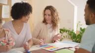 istock Female interior designer visiting clients at home 641930464