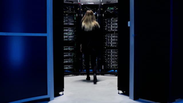 Female IT Engineer Working in Server Room Female IT Engineer Working in Server Room. server room stock videos & royalty-free footage