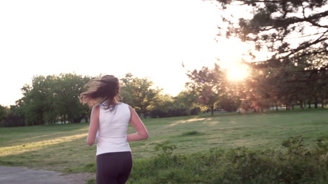 Female Jogger Woman Running at Sunset video