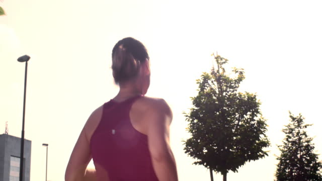 SLO MO TS Female jogging in the city video