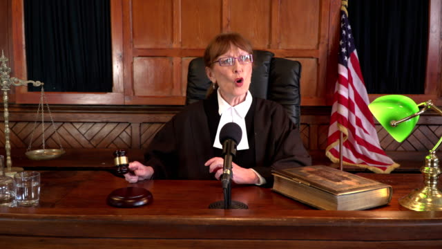 https://media.istockphoto.com/videos/female-judge-in-courthouse-using-gavel-video-id651511798?s=640x640