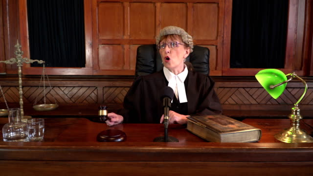 4K DOLLY: Female Judge in Courtroom calling order video