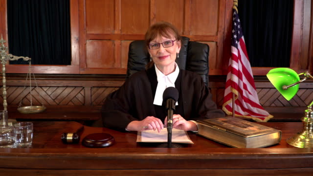 4K DOLLY: USA Female Judge in Courtroom smiling at the camera video