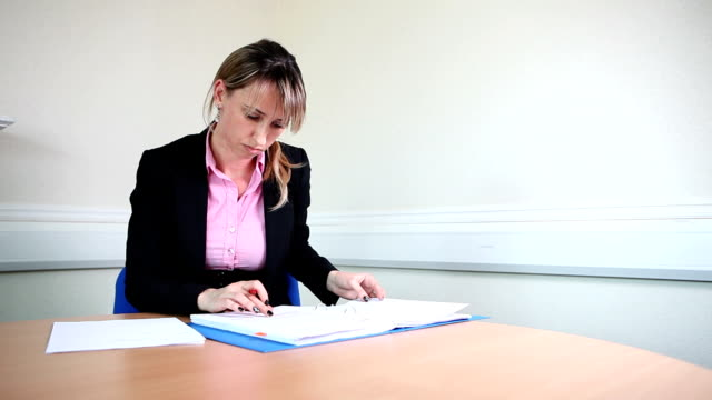 Female lawyer signing contracts video
