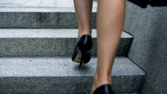 Female legs walking upstairs, concept of successful career path, promotion