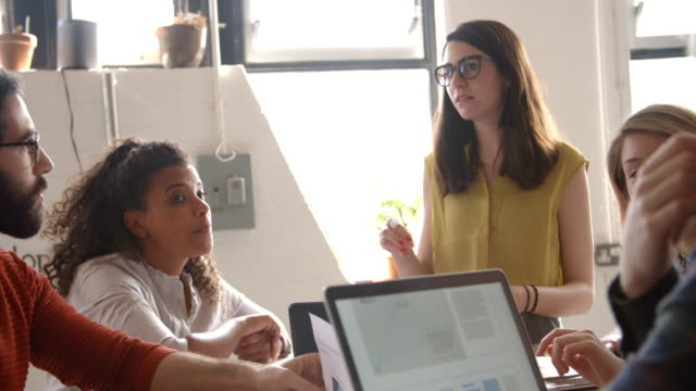 Female Manager Leads Brainstorming Meeting In Design Office video