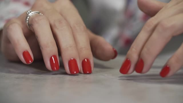 female manicure of arm close up. close up of woman's fingers with red nails - ноготь на руке стоковые видео и кадры b-roll