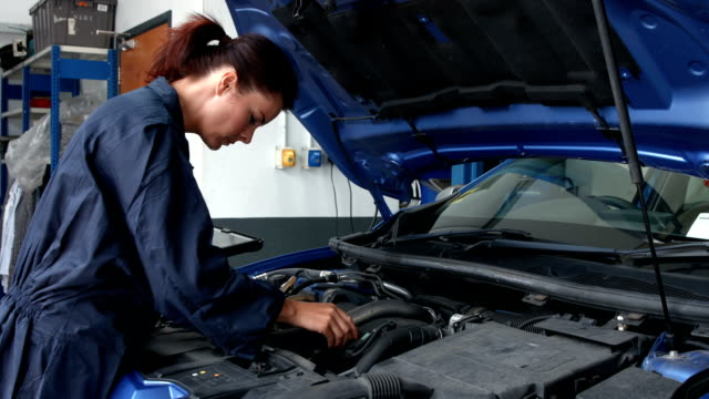 Female mechanic overhauling an engine video