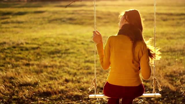 Female Model Fixing Hair Autumn Field Swing video