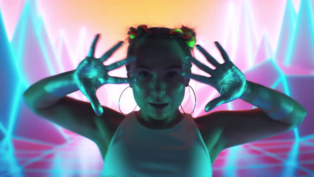 Female modern dancer performing on projection background. Inside surreal, digital landscape with purple mountains and neon lightning