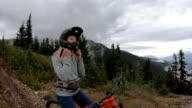 istock Female mountain biker descends mountain trail 1170135131