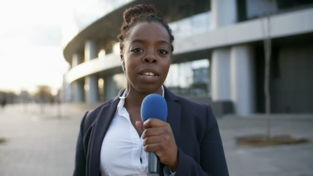 Female News Reporter Lockdown of female African news reporter making reportage from the scene journalist stock videos & royalty-free footage