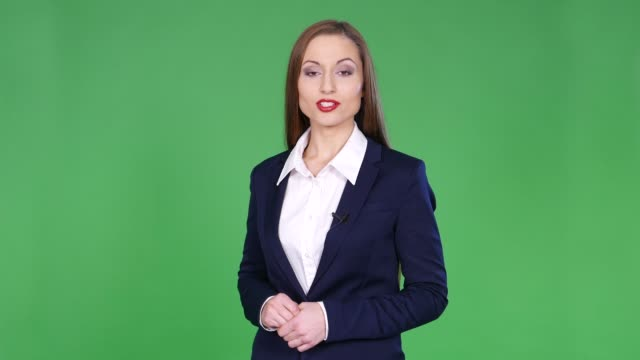 4K Female newscaster on green background 4K Female newscaster on green background television host stock videos & royalty-free footage