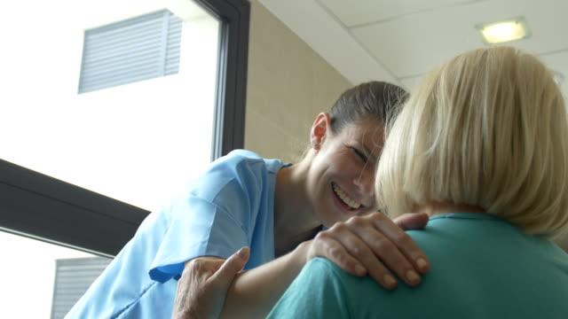 Female nurse communicating with senior woman video