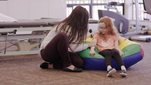 Female occupational therapist working with child patient video