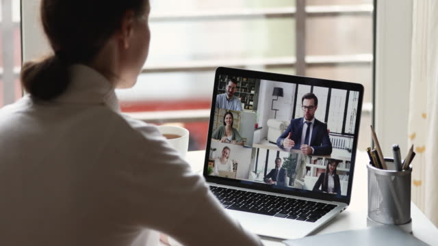 Female office worker working from home video conferencing businesspeople group