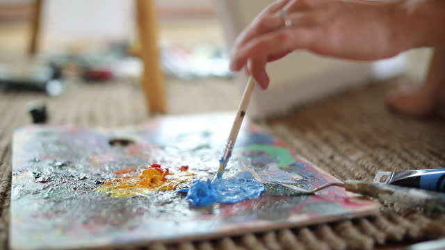 Female painter mixing colors video