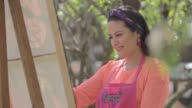 istock Female painter working. 1214634953