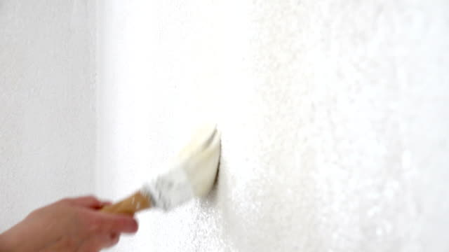 female painting wall - poster стоковые видео и кадры b-roll