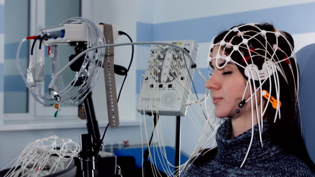 Female patient getting EEG exam and EEG scan on monitor Female patient getting EEG exam and EEG scan on monitor electrode stock videos & royalty-free footage