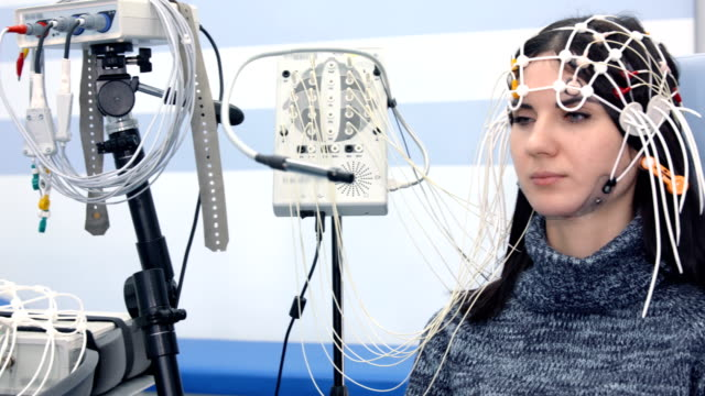 Female patient getting EEG exam Female patient getting EEG exam electrode stock videos & royalty-free footage