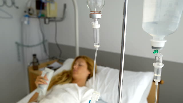 A female patient in a hospital ward with a drip video