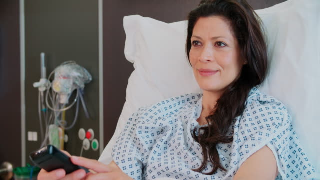 Female Patient In Hospital Bed Watching Television video