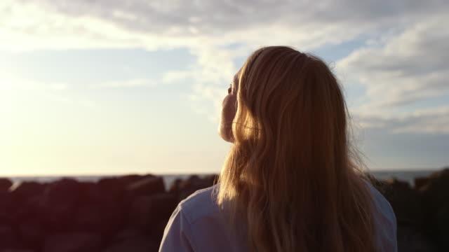 Female Photographer Using Slr Camera On Beach