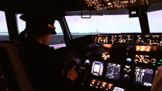 Female pilot captain prepares for take-off plane Female pilot the captain of the plane prepares for take-off in the plane cockpit. Girl pilot in uniform flying craft plane in the sky military private stock videos & royalty-free footage