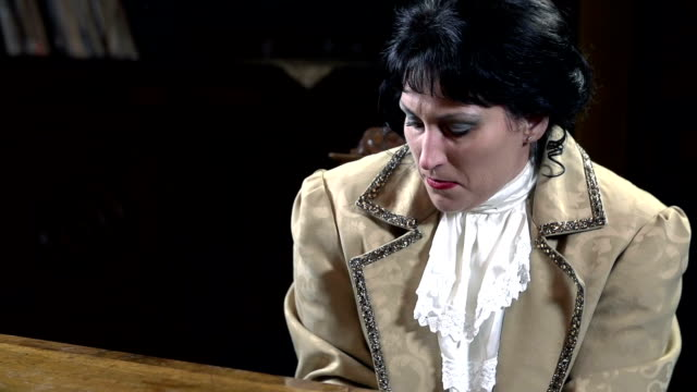 HD SLOW: Female playing piano in romanesque clothes video